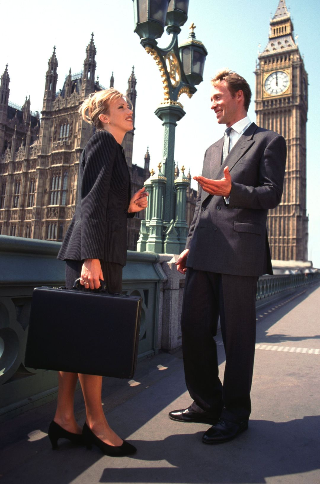 England, London, Businesspeople talking, smiling