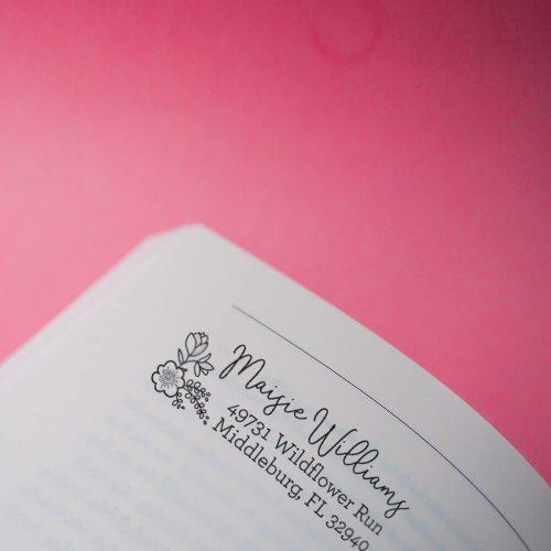 floral address stamp on book