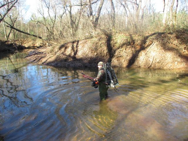 Brannon crosses a creek.