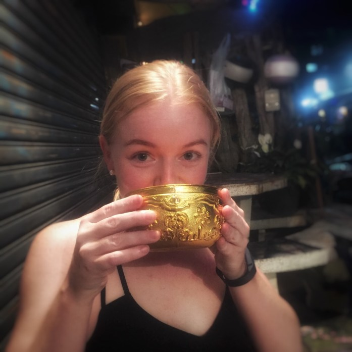 Kim drinking from the golden chalice