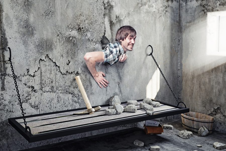 http://www.shutterstock.com/pic-213356638/stock-photo-man-who-broke-the-wall-in-prison-creative-concept.html?src=XTpRp685TGU0T2qaQjX55w-1-35