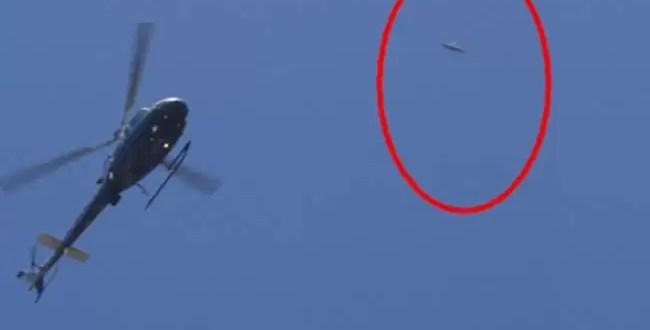 Foto: Un OVNI pasa junto a un helicóptero