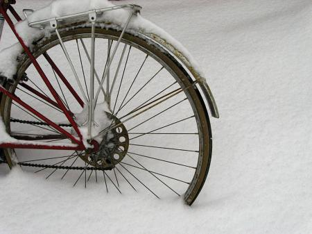 Bike wheel in snow