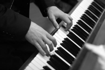 Sasha Ilnyckyj playing the piano