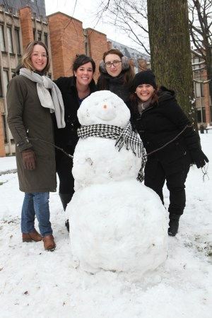 Julie Smitka, Jen Bonder, Kristina, and Mary Triny Mena with a snowman in the Massey College quad