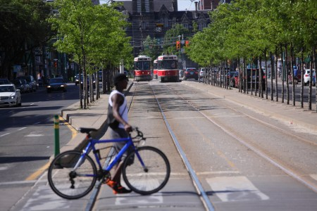 Cyclist and two streetcars