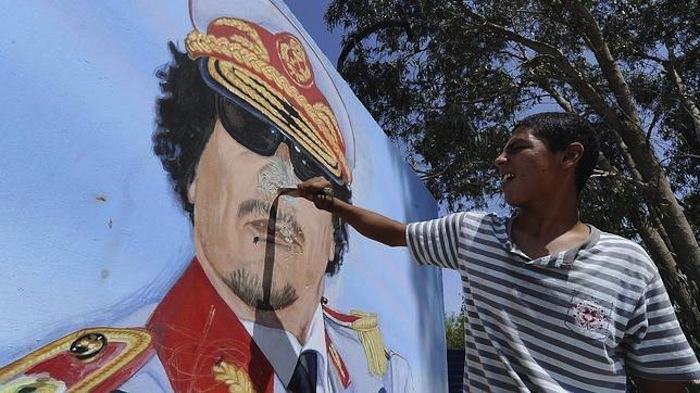 Gobiernos autoritarios como el de Muamar Gadaffi se encuentran entre los clientes de Hacking Team. Foto: EFE