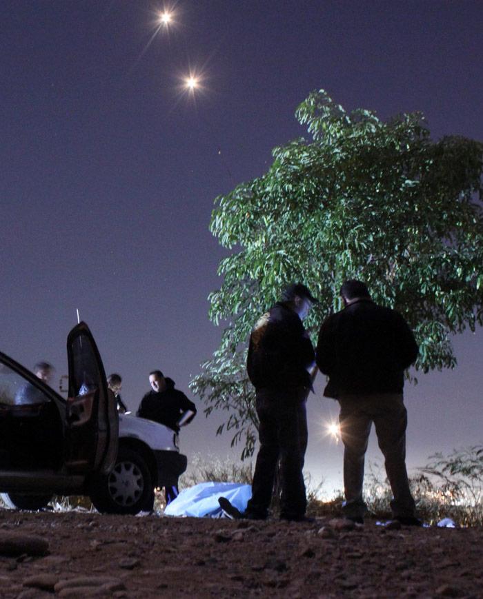 Agente de la policía municipal ejecutado en Culiacán, Sinaloa. Foto: Cuartoscuro