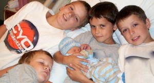 Four Older Brothers Holding Baby Kaleb