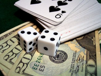 Game pieces (cards & dice) and money