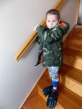 Kaleb with gloves on his feet.