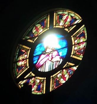 Stained Glass church window with Light streaming through