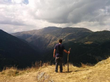 Man looking out from mountaintop