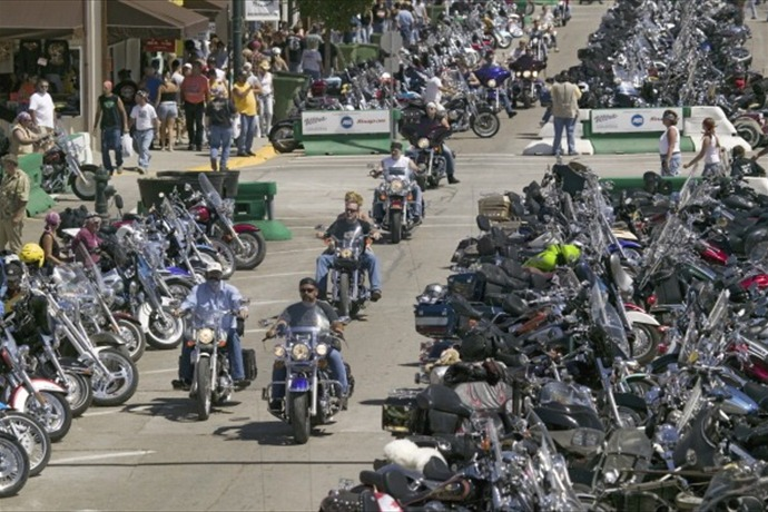 Elevated view of Main Street with motorcycles lining road at the 67th Annual Sturgis Motorcycle Rally, Sturgis, South Dakota, Au_-2041692686032420506
