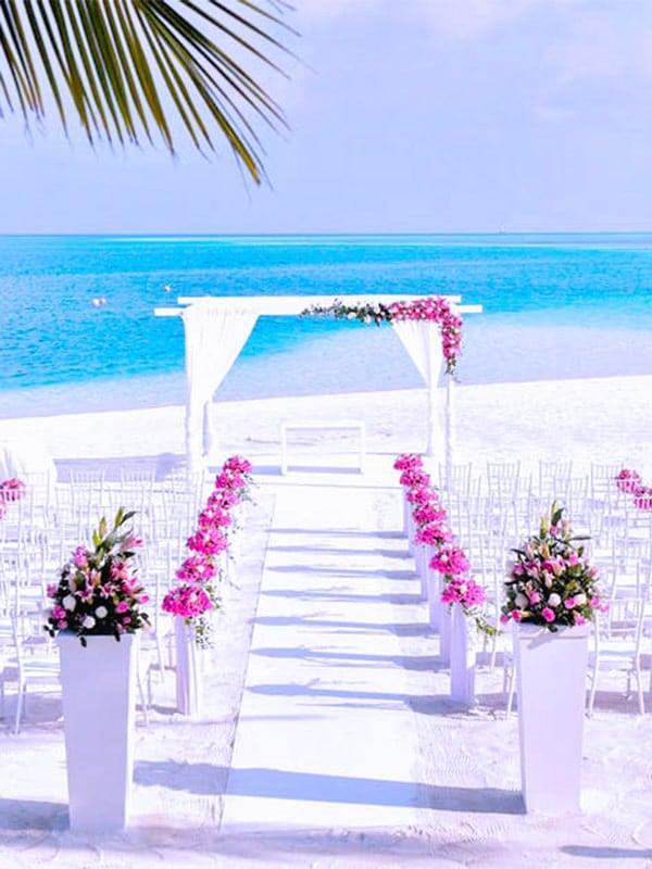 wedding reception smallbeach wedding destination pink ribbon chairs blue min