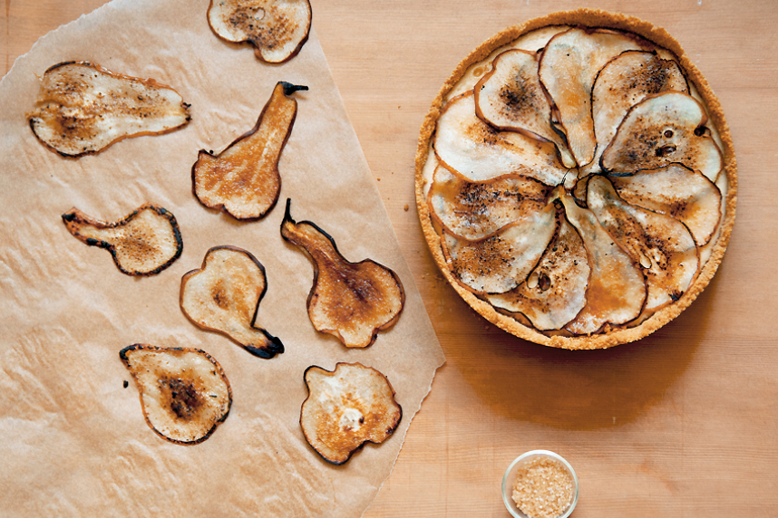 maple cheesecake with thinly sliced charred pears