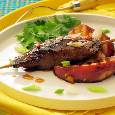 grilled duck satay with peaches