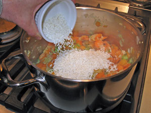 adding rice to the mirepoix