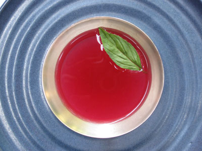 thai basil floating on blood orange cocktail martini