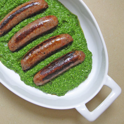 grilled sausages with arugula pesto