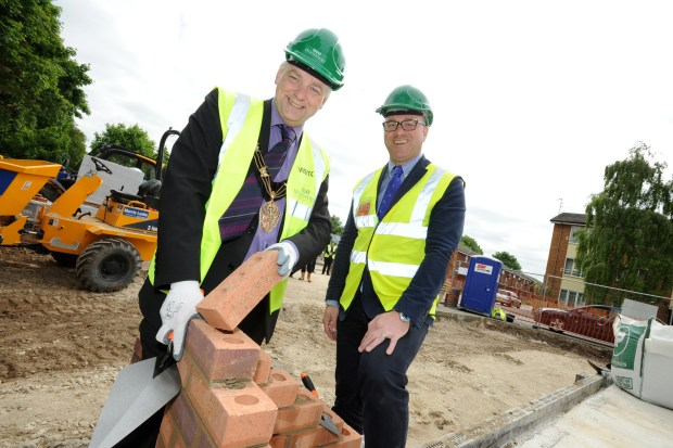 The Mayor of Lincoln Cllr Andrew Kerry and Construction Director of Woodhead Living Craig Pygall lay the first bricks in Eastleigh Close.