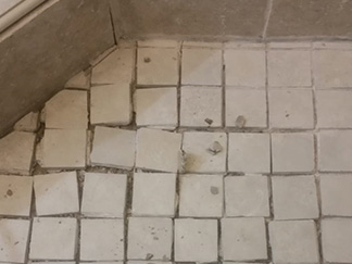 what causes grout to crack and crumble