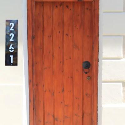 address sign vertical red door