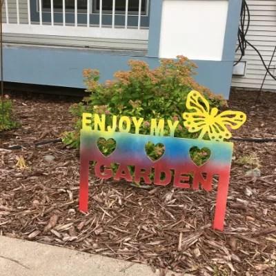 metal garden sign multi bright in garden