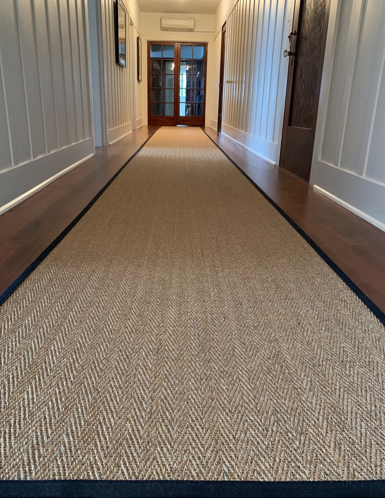 Clean hallways: Astute, in color curry, is a tightly woven natural sisal weave that does not shed.