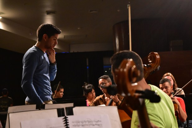 Felix Briceño leads a rehearsal with young musicians in Aragua, Venezuela