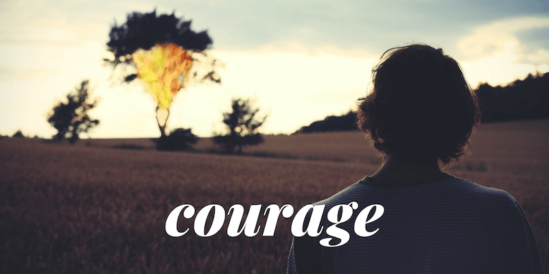 "The word ""Courage"" in white overtop of a woman standing in the sunset"