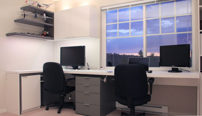 The office desk with the task desk tucked into its storage spot in the left and return