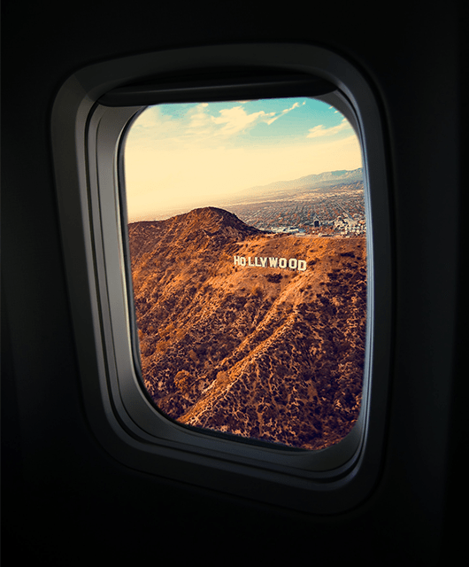 Hollywood Sign Outside Airplane Window
