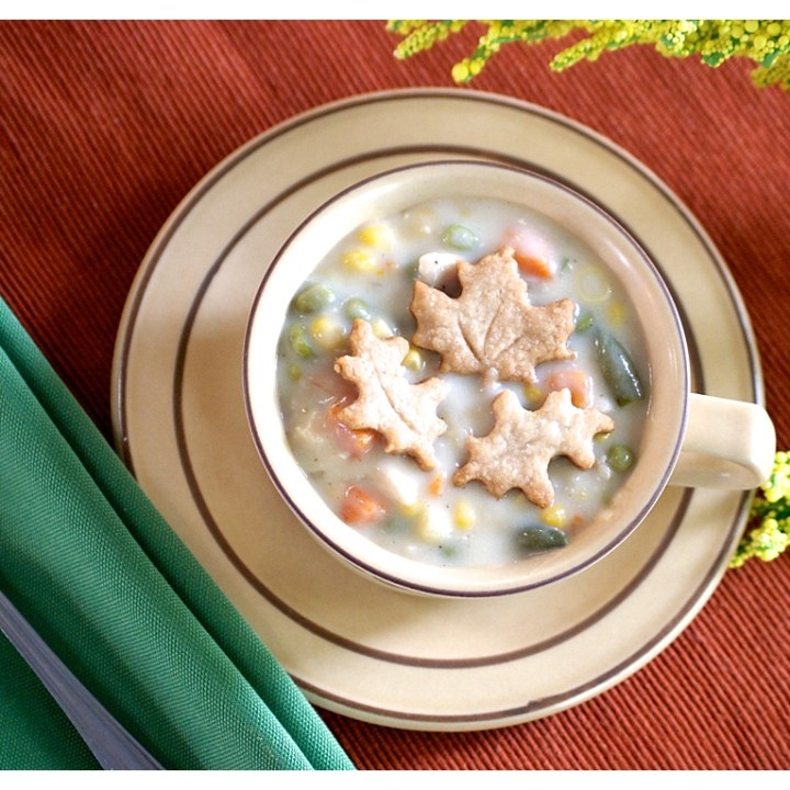 Creamy Chicken Pot Pie Soup with Flaky Pie Crust Leaves