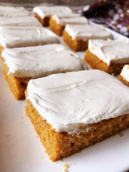 Pumpkin Bars | Sheet Cake Recipe | Fall Dessert | Sheet Cake Pan | Dessert for a Crowd | Fall | Autumn | Fall Desserts | Thanksgiving | Pumpkin Recipes | Pumpkin Dessert | Pumpkin Cake | Easy Dessert | Easy Recipe | Cream Cheese Frosting | Sheet Cake Pumpkin Bars on Six Clever Sisters!