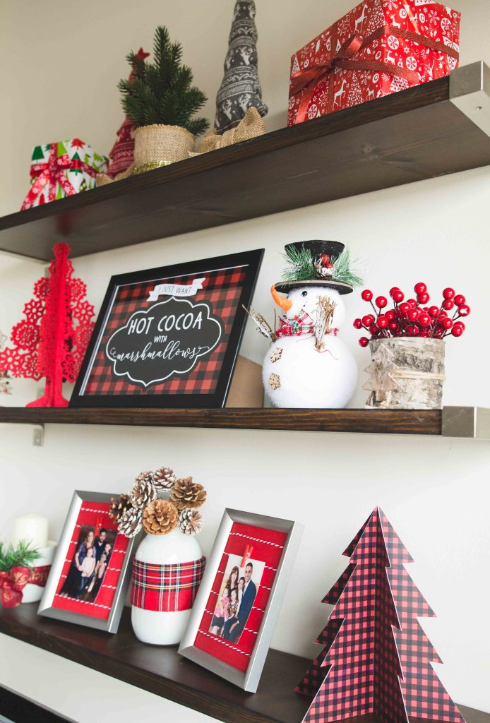Decorating floating shelves for Christmas | Christmas floating shelves | Floating Shelf Christmas decor | | Decorating Kitchen Shelves for Christmas | How to Style Floating Shelves for Christmas - Tips for styling on a budget! All the details on the Six Clever Sisters blog.