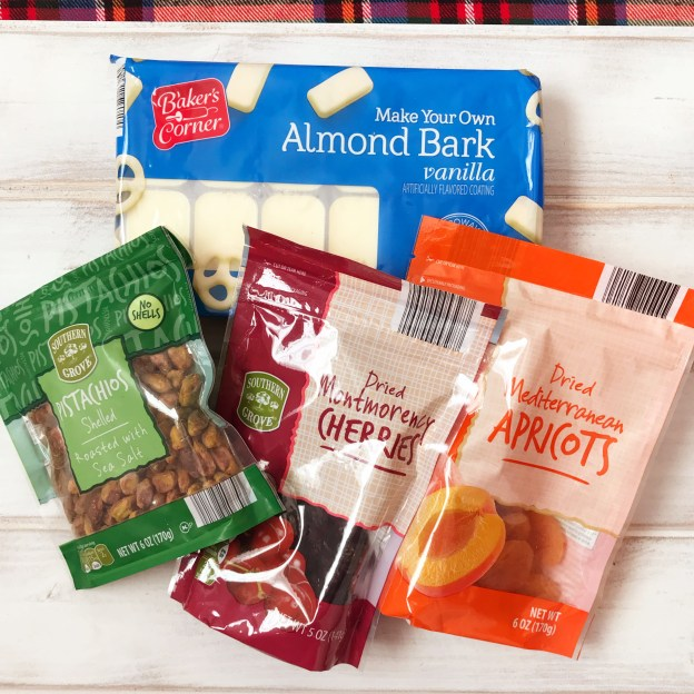 Aldi stores | Aldi Shopping | Frugal Christmas | Homemade Christmas | Chocolate Bark | Fruit and Nut | White Chocolate | Gift Idea | DIY Gift | Christmas Gift | Christmas Candy | Christmas | Holiday | Christmas Bark | Dried Fruit | Frugal Gift | Cheap Christmas Gift | Handmade | Recipe on Six Clever Sisters