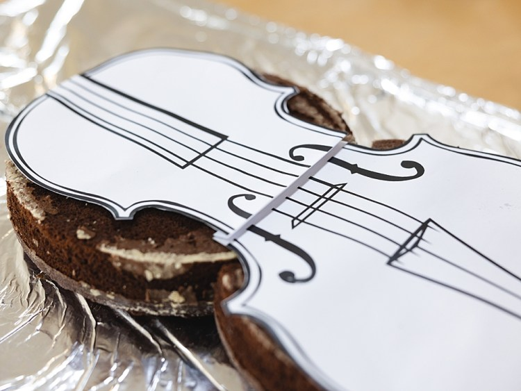 How to Make a Violin Shaped Cake | Violin Cake Ideas Birthday | How to Make a Violin Cake | Violin Birthday Cake | Violin Birthday Ideas | Step-by-step directions + printable template on the Six Clever Sisters blog!
