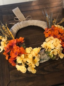 Fall Wreath   Dollar Tree   Autumn Decor   Easy Handmade Wreath   Dollar Tree Decor   Dollar Tree Hack   DIY Fall Wreath   DIY Fall Decor   Cheap Fall Wreath   Dollar Tree has all the florals and supplies you need to make yourself a beautiful fall wreath this year! Find out how I made mine at SixCleverSisters.com