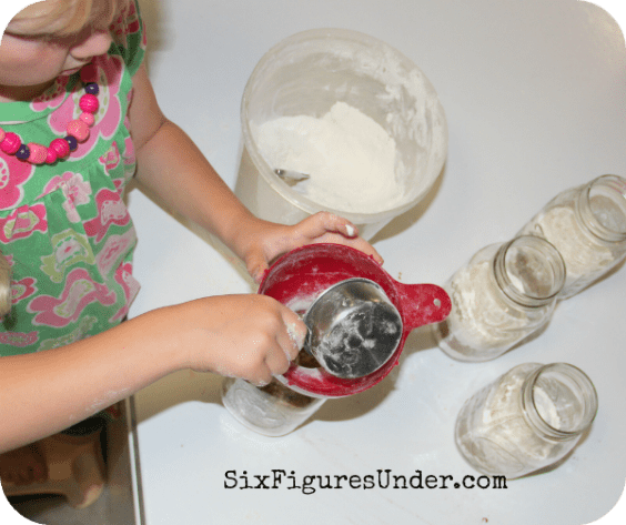 Homemade Fudgy Brownie Mix layered in a jar makes a frugal, thoughtful and delicious gift! Kids can even help make a teacher's gift.