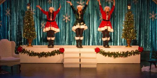 Three performers singing.