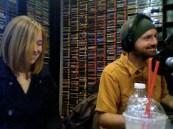 Saint John on the radio, amused with himself.