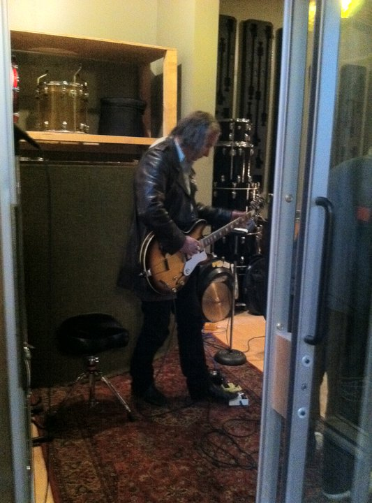 Peter Buck about to record a track.
