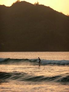 Sunset surfing at Hanalei Bay.