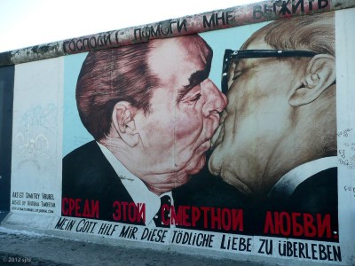 "Three-quarters of a mile of THE wall remains. It's called the ""Eastside Gallery."" Many artists have added their 2-cents."