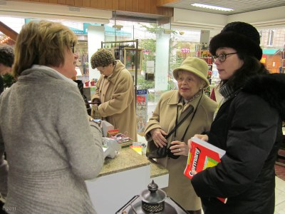In the bookstore buying a map from Frau Blucher.