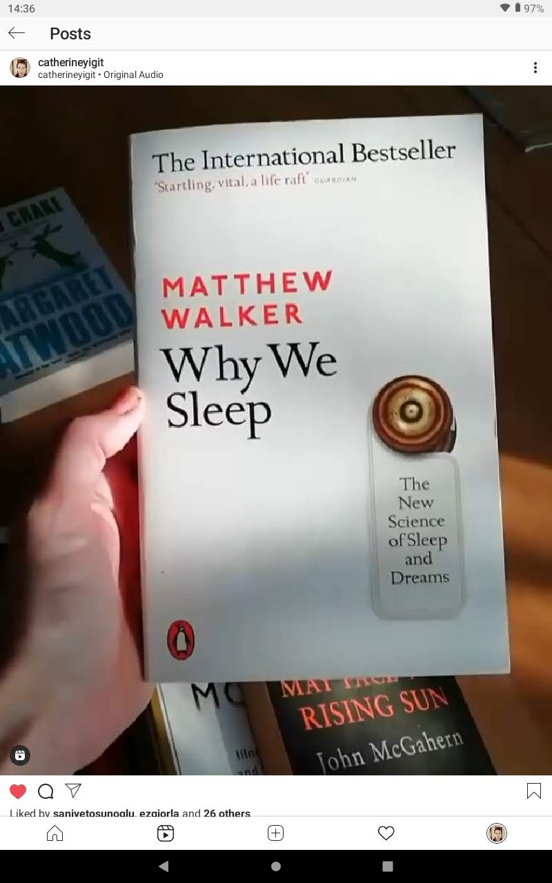 A hand holding the book Why We Sleep by Matthew Walker