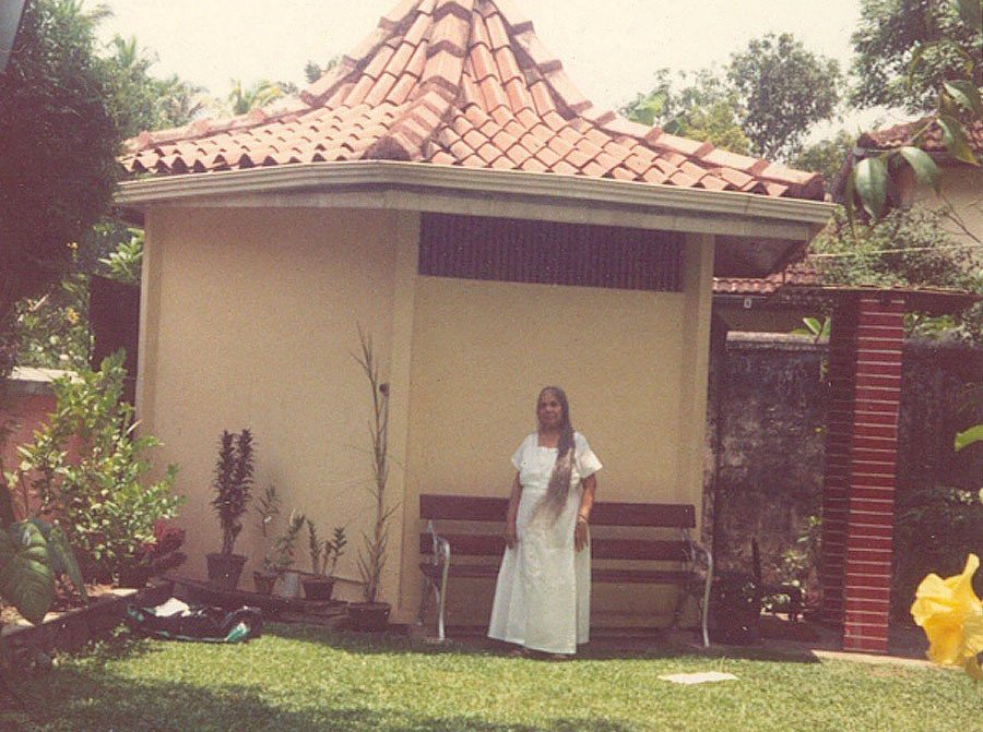 Guru's mother and her multi-faith temple, set in the grounds of the family home in Colombo, Sri Lanka.