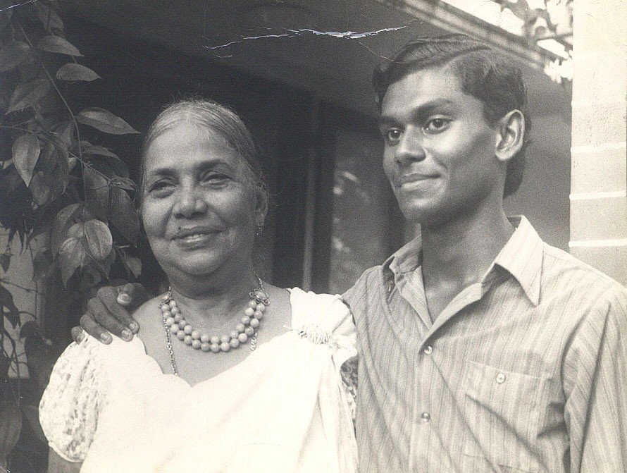 A black and white photo of Guru Sri Subramanium as a young man, pictured with his mother in Sri Lanka.