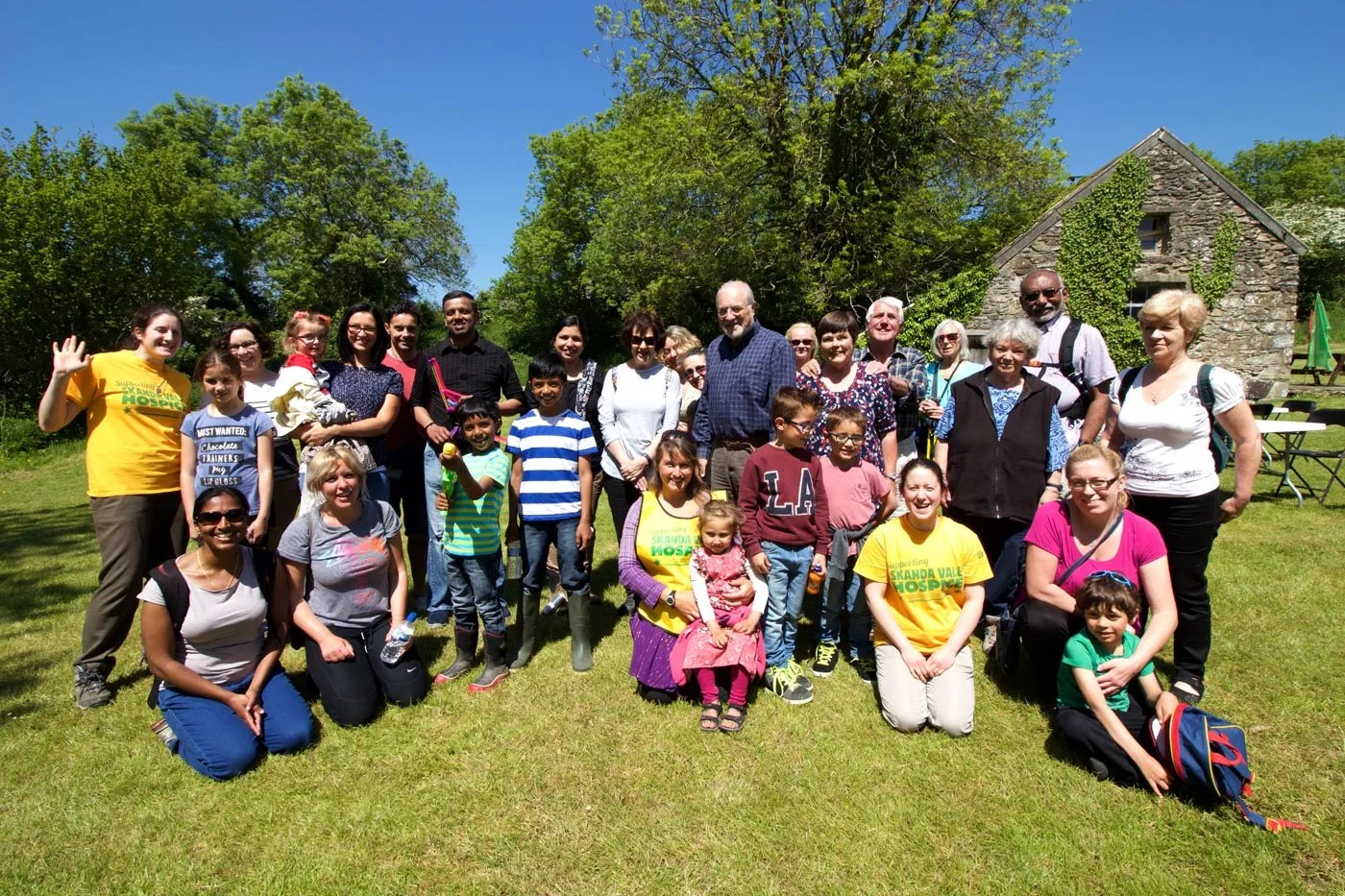 Group photo of sponsored walkers at Pentre Ifan gatehouse